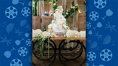 wedding cake with flowers on rolling table